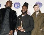 Scottish band Young Fathers after winning the 2014 Mercury Prize in London.