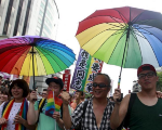 Participants hold rainbow umbrellas during a rally to demanding the Taiwanese government to legalize same-sex marriage in front of the ruling Nationalist Kuomintang Party headquarters in Taipei, Taiwan, July 11, 2015.
