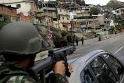 Brazilian soldiers take position in the Lins Favela Complex in Rio de Janeiro.