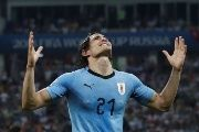 Uruguay's Edinson Cavani celebrates scoring their second goal.
