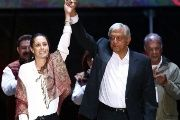 Claudia Sheinbaum (L), and Mexican presidential candidate Andres Manuel Lopez Obrador gesture during his closing campaign rally in Mexico City, Mexico June 27, 2018.