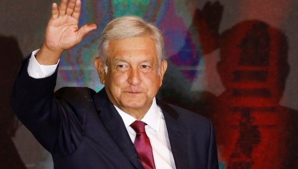 Presidential candidate Andres Manuel Lopez Obrador waves as he addresses supporters after polls closed in the presidential election, in Mexico City.
