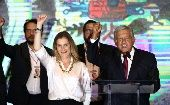 Presidential candidate Andres Manuel Lopez Obrador gestures with his wife Beatriz Gutierrez Muller and family as he addresses supporters after polls closed in the presidential election in Mexico City, Mexico Sunday.