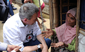 Peter Maurer, president of the International Committee of the Red Cross (ICRC), interacts with a Rohingya woman during his visit to a refugee camp in Cox