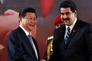 China's President Xi Jinping (L) and Venezuela's President Nicolas Maduro shake hands during a signing ceremony in Caracas July 21, 2014.