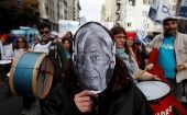 A teacher wears a Christine Lagarde mask during a protest at the Ministry of Education in Buenos Aires to demand better pay.