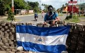 A protester on the Pan-American highway during a protest against Nicaraguan President Daniel Ortega in Jinotepe, July 5.