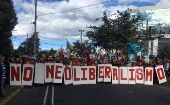 Protesters reject neoliberal reforms and show their support for Rafael Correa.