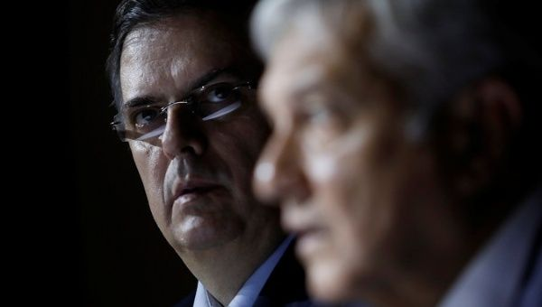 Marcelo Ebrard looks on as Mexico
