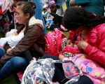 Mothers breastfeed their babies, as part of the celebration for World Breastfeeding Week, at Lovers Park in Bogota, Colombia.