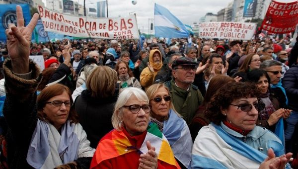 Demonstrators attend a protest against the President Mauricio Macri
