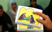 A counselor holds up cards used to educate women about female genital mutilation (FGM).
