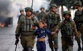 Israeli forces datain a Palestinian child in the occupied West Bank.