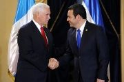 U.S. Vice President Mike Pence shakes hands President Jimmy Morales before a meeting at the National Palace of Culture in Guatemala City, Guatemala June 28, 2018.