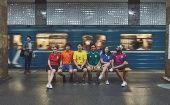Gay rights activists, wearing soccer jerseys to form a rainbow flag, walk in Moscow