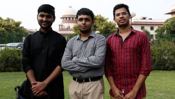 Anwesh Pokkuluri, Romel Barel and Krishna Reddy M, petitioners challenging Section 377 of the Indian Penal Code that criminalises homosexuality, pose outside the premises of the Supreme Court in New Delhi, India, July 10, 2018.