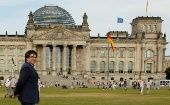 Former Catalan President Carles Puigdemont walks in front of the Bundestag in Berlin.