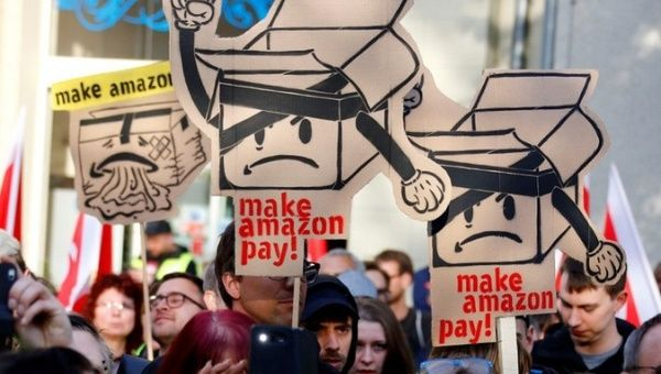 Amazon workers and activists protest ahead of the annual Axel Springer award ceremony in Berlin.