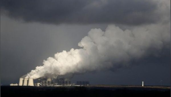Smoke rises from a coal power plant.