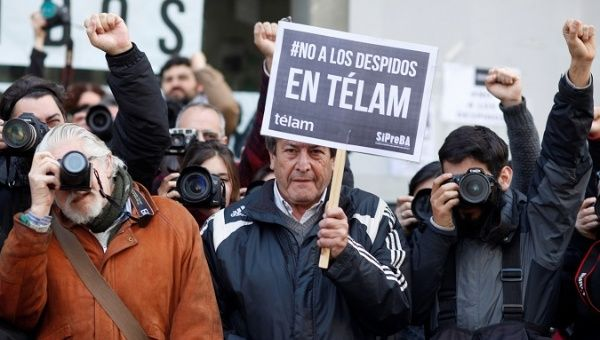 Argentine journalists protest the lay-off of over 300 employees from public news agency Telam in Buenos Aires.
