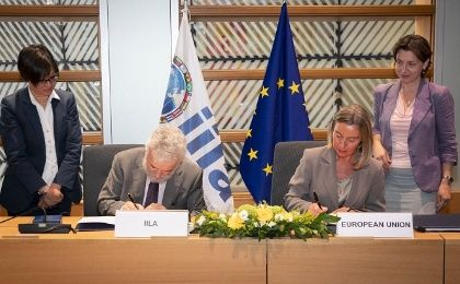 Delegates of EU and Celac sign a joint statement after two days of meetings in Brussels.