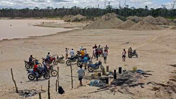 "File photo: Inhabitants of the Manaui basin in ""La Pampa,"" visiting one of the most affected areas by illegal gold mining. March 21, 2012"