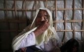 Roshan Begum, a Rohingya refugee, wipes her eyes after hearing the news that her son has been found in Buthidaung prison in Myanmar.