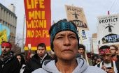 People march during a protest in Bismarck against plans to pass the Dakota Access pipeline under Lake Oahe and near the Standing Rock Indian Reservation, North Dakota