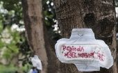 A sanitary towel with the message 'menstruation is not an illness', pinned on a tree during a protest in Kolkata, India.