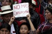 People march against corruption in the Central American country.