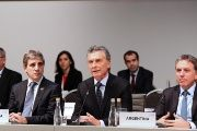 Argentine President Mauricio Macri speaks alongside Treasury Minister Nicolas Dujovne (R) and Central Bank President Luis Caputo at the G20 Meeting of Finance Ministers in Buenos Aires, Argentina, July 22, 2018