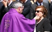 Bishop Juan Barros giving the communion to Lucía Hiriart, former wife of dictator Augusto Pinochet in December 2006