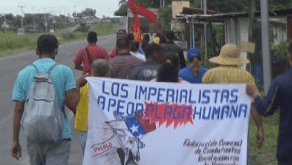 TheAdmirable Peasants March on its way to Caracas for almost two weeks, holding a sign against imperialism in Venezuela