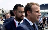 French President Emmanuel Macron walks ahead of his aide Alexandre Benalla at the end of the Bastille Day military parade in Paris, France, July 14, 2018