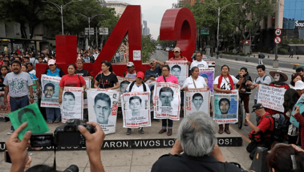 Relatives with images of the 43 missing Ayotzinapa College Raul Isidro Burgos students in Mexico.