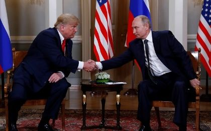 U.S. President Donald Trump and Russia's President Vladimir Putin shake hands as they meet in Helsinki, Finland July 16, 2018.