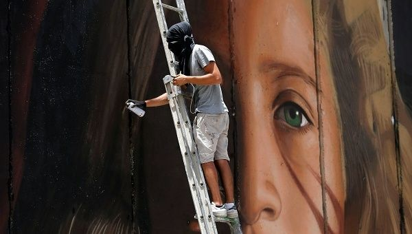 The 13-foot mural is the creation of Italian street artist Agostino Chirwin, who has a reputation for painting activists.