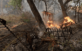 A wooden structure burns on the south edge of the Carr Fire near Igo, California, U.S. July 29, 2018.