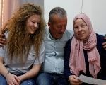 Palestinian teenager Ahed Tamimi sits next to her father and her mother Nareman, at their family house in Nabi Saleh village in the occupied West Bank July 30, 2018.