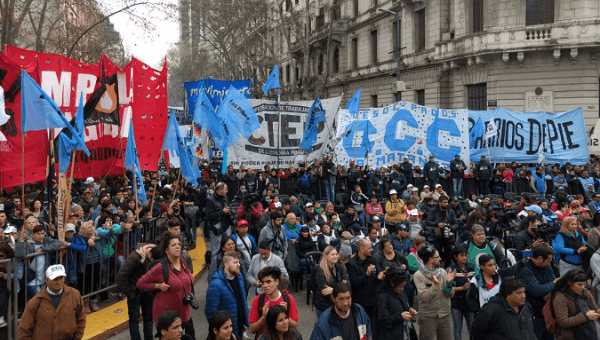 Workers march towards the presidential palace in Buenos Aires.