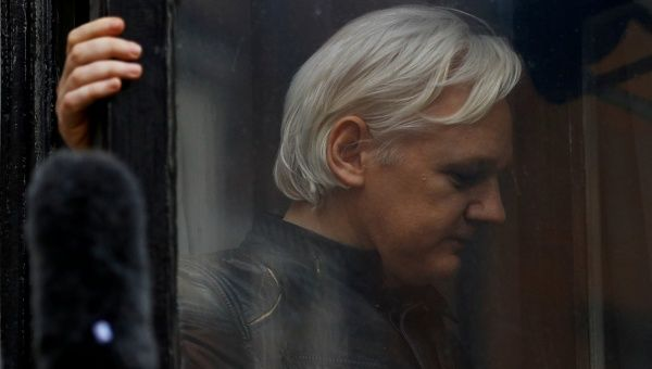 WikiLeaks founder Julian Assange is seen on the balcony of the Ecuadorean Embassy in London, Britain, May 19, 2017.