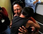 Estanislao Perez hugs his son Keidin after they were separated at the U.S. border, in Guatemala, August 7, 2018.