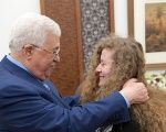 Palestinian President Mahmoud Abbas meets with freed Palestinian teenager Ahed Tamimi after she was released from an Israeli prison, in Ramallah in the occupied West Bank July 29, 2018.