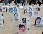 Photos of missing people mark International Day of the Victims of Enforced Disappearances in Medellín, Colombia, August 2016.