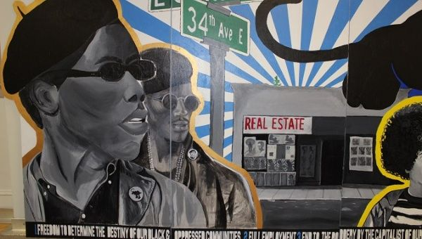 A mural commemorates the story of the Seattle chapter of the Black Panther Party, April 27, 2018.