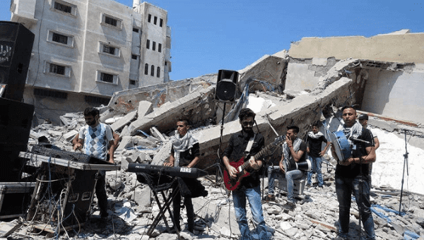 Palestinian musicinas perform on the ruins of Gaza