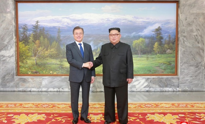 South Korean President Moon Jae-in shakes hands with North Korean leader Kim Jong Un during their summit at the truce village of Panmunjom. May 2018