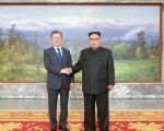 South Korean President Moon Jae-in shakes hands with North Korean leader Kim Jong Un during their summit at the truce village of Panmunjom, North Korea, on May 27, 2018.