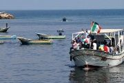 Palestinians ride a boat as they take part in a rally to show solidarity with Gaza-bound flotilla Oct. 5, 2016..