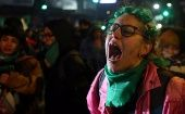 A woman reacts outside Congress after senators rejected a bill to legalize abortion in Buenos Aires, Argentina, August 2018.